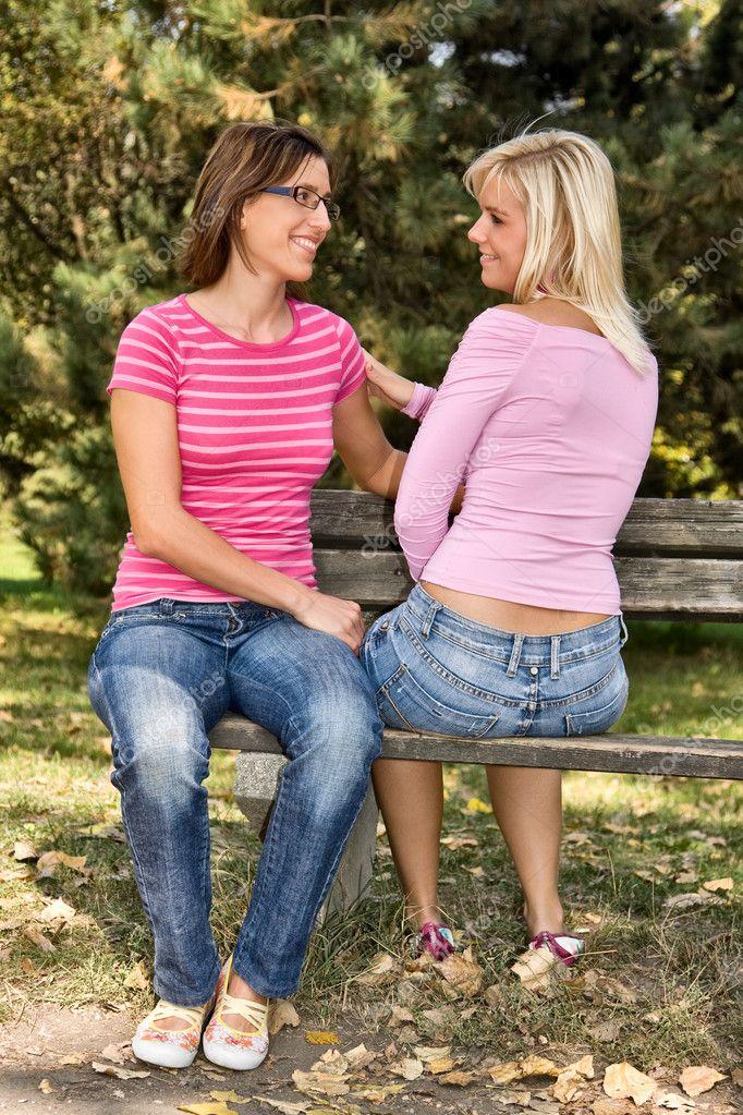 Two Girls Talking On A Bench Stock Photo 169 Kostudio 2456198