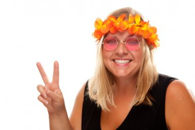 Smiling Hippie Girl gives Peace Sign