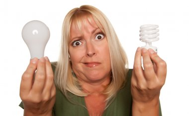 Confused Blonde Holds Energy Saving Lightbulb