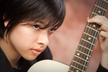 Attractive Ethnic Girl Playing Guitar