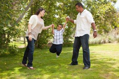 Hispanic Man, Woman and Child having fun