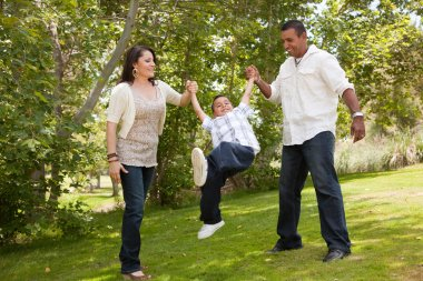 Hispanic Man, Woman and Child in Park