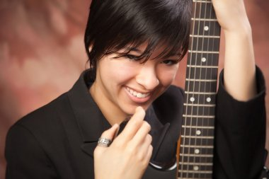 Multiethnic Girl Poses with Her Guitar