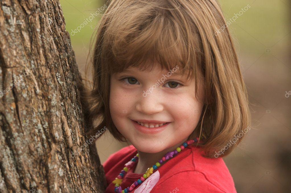 Adorable Young Girl Having Fun at the Park.