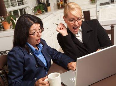 Two Women Using Laptop Celebrate Success