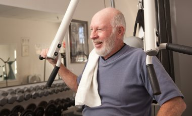 Senior Adult Man Working Out in the Gym.