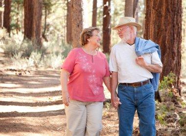 Loving Senior Couple Walking Outdoors