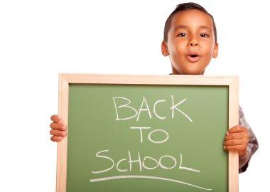 Young Hispanic Boy Holding Chalkboard
