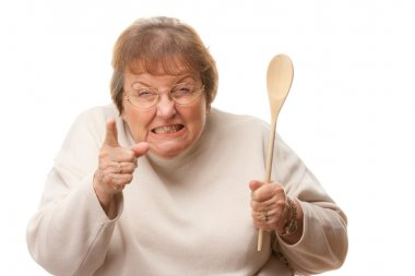 Upset Senior Woman with The Wooden Spoon Isolate
