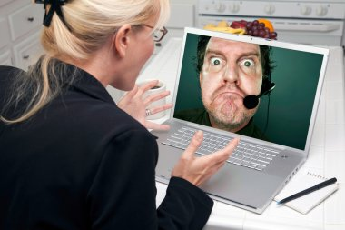 Girl Using Laptop with Man on Screen