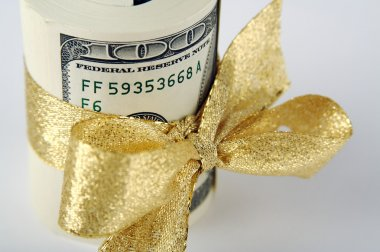 One Hundred Dollar Bills Wrapped in Gold