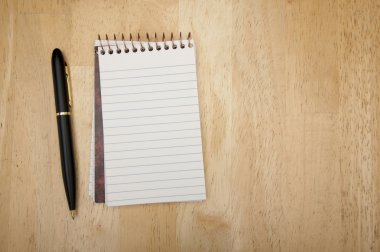 Note Pad and Pen on Wood
