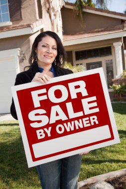 House and Woman Holding For Sale Sign