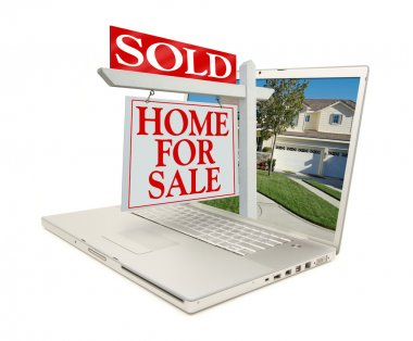 Sold Home for Sale Sign On Laptop
