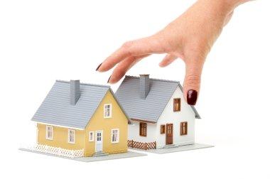 Female Hand Choosing A Home