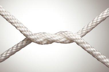 Nylon Rope Knot on a Spot Lit Background.