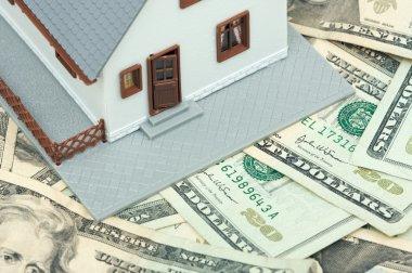 Model House Resting on Money