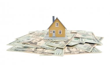 Model Home and Stack of Money on White