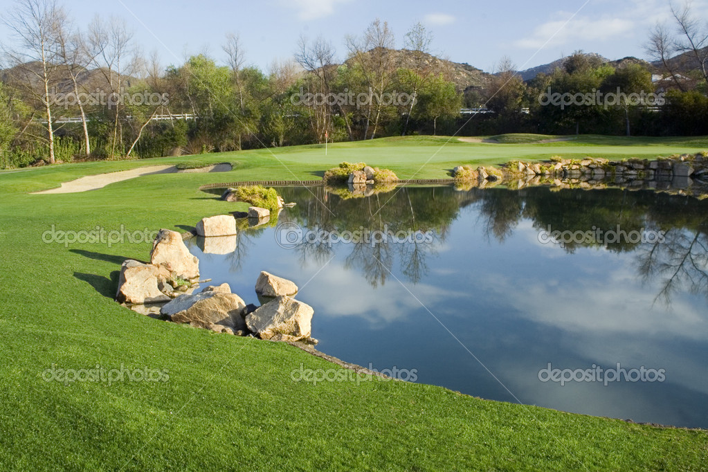 Golf Green, Lake and Lush Green Grass