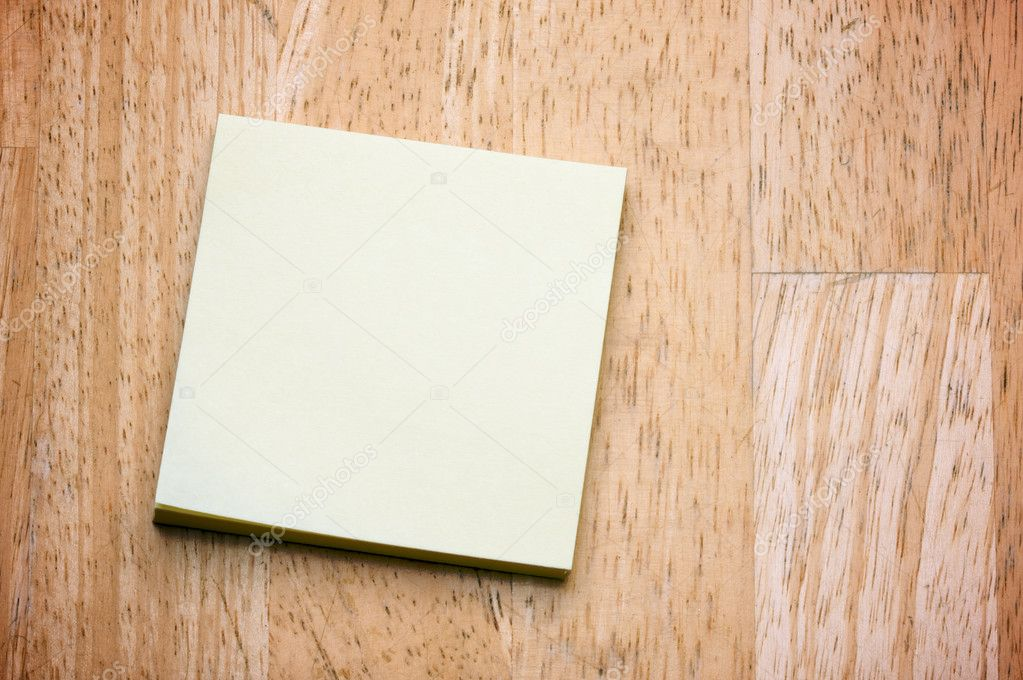 Post It Note Pad on a Wood Background