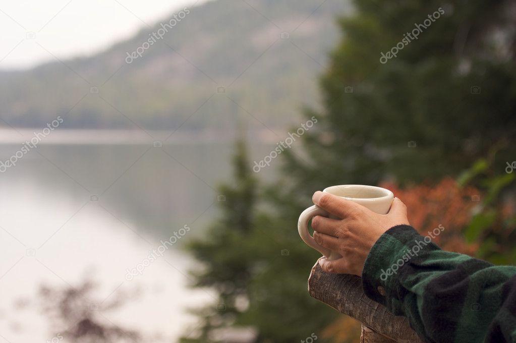 Woman Enjoys Morning Cup Coffee at Lake