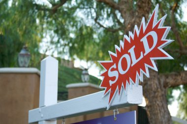 Sold Burst Sign with Trees and Structure