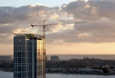 Silhouette of Crane and Building