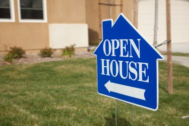 Blue Open House Sign and House Front