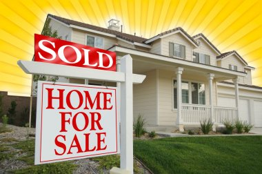 Sold Home For Sale Sign and New House