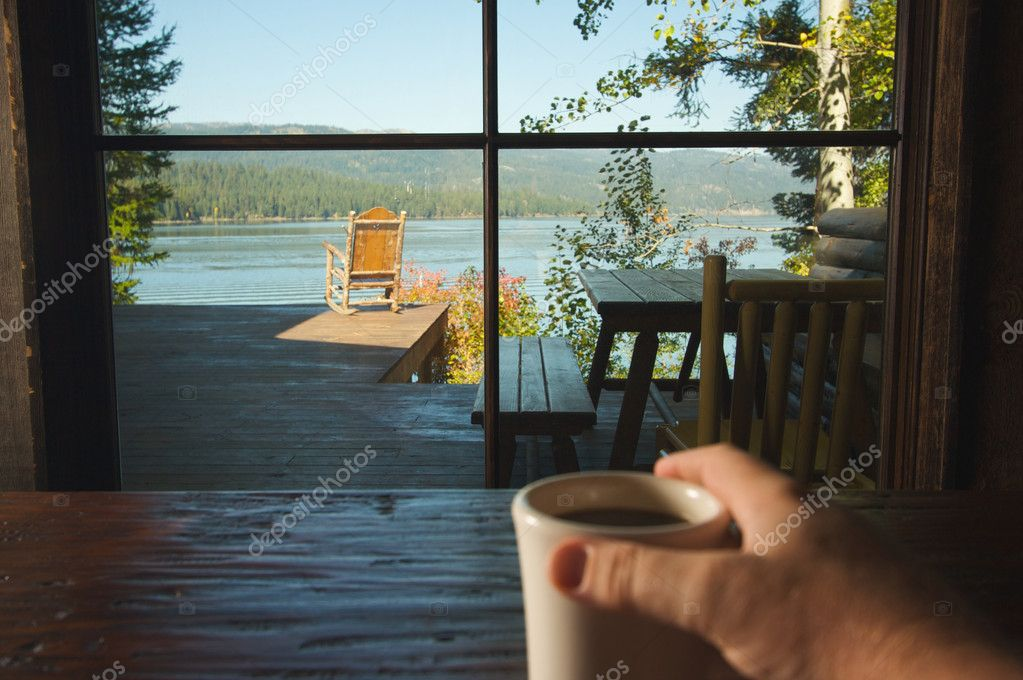 Looking At View, Man Holds Cup of Coffee