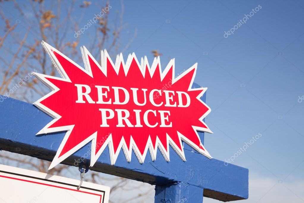Red Reduced Price Burst Real Estate Sign.