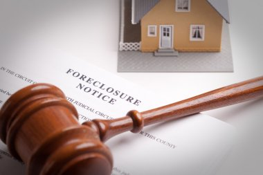 Foreclosure Notice, Gavel and Model Home