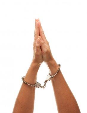 Handcuffed Woman Raises Praying Hands