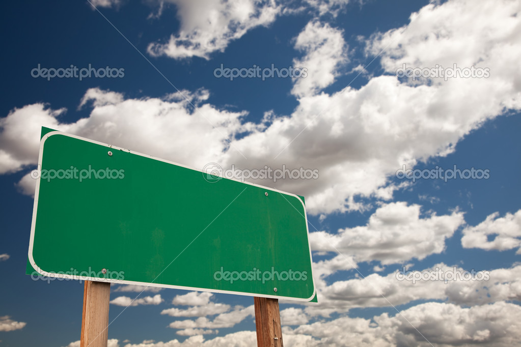 Blank Green Road Sign on Blue Sky