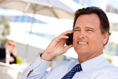 Photo Smiling Businessman on Cell Phone