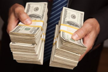 Businessman Holding Stacks of Money