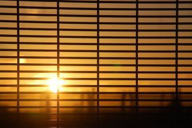 Windows blinds with sunrise