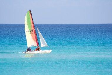 Small sailboat in a calm blue sea