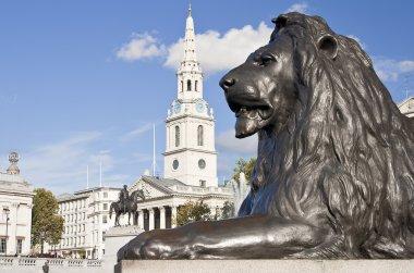 Statue of a lion in Trafalgar Square in London