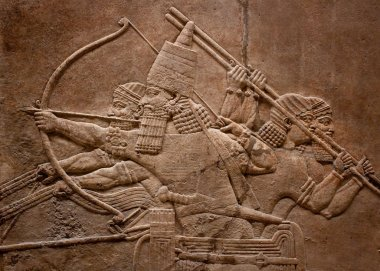 Ancient relief of assyrian fighting