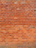 Fotografie červené cihly zdi