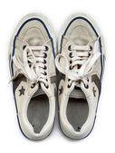 Fotografia vecchio bianco indossati scarpe da ginnastica, visti dallalto