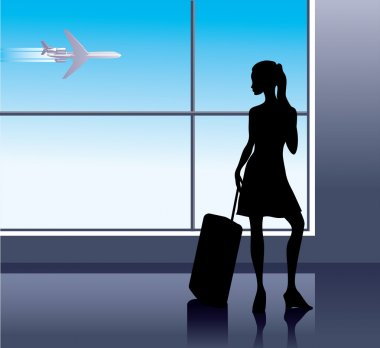 Girl with baggage in airport