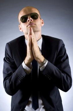 Businessman praying for success