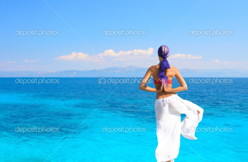 Photograph of a beautiful woman in a sarong medi
