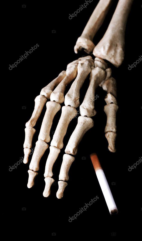 Skeleton hand drop a cigarette
