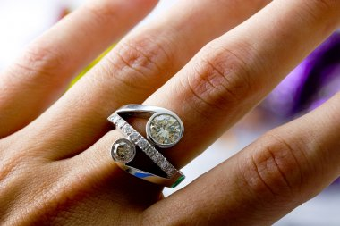 Diamond gold cocktail ring on a finger