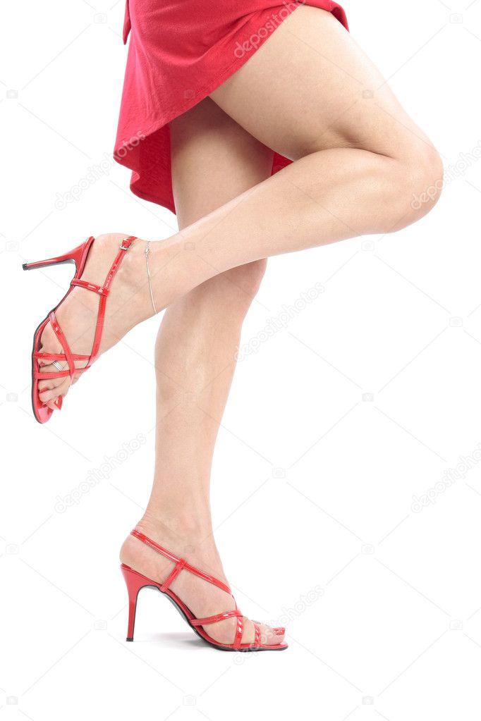 Frau Beine und Füße mit rotem Kleid — Stockfoto © Strobos #2482406