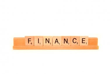 The word Finance spelled out in wood tiles isolated on a white background stock vector