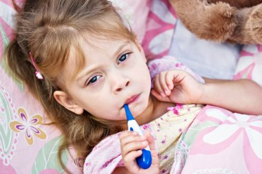 Ill Child with Thermometer